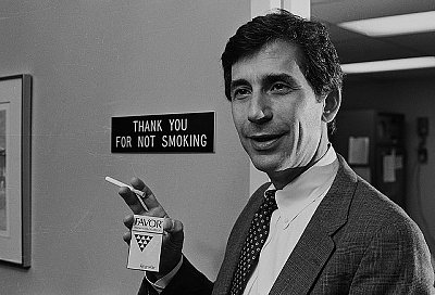 Dr. Norman Jacobson Holding Cigarette